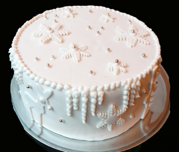 Simple white Christmas cake with snowflakes