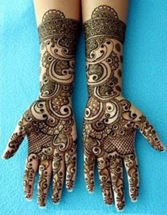 girls apply mehndi on their legs and arms for decoration especially in wedding in india and pakistan mehndi is integral part of wedding ceremonies